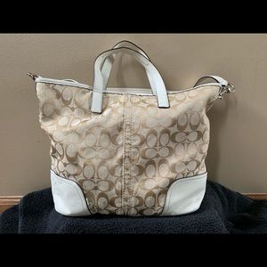 Cream colored Coach signature print purse